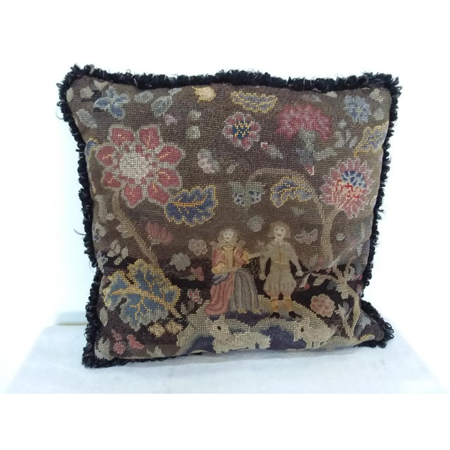 Antique needlepoint pillow with figures and flowers. Great looking early American Style pillow.