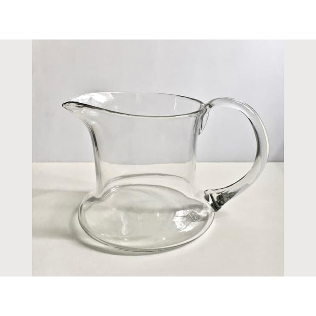 "Summery Hand Blown Clear Glass Pitcher. Juice. Water. Punch. Bloody Mary's. With wide 6D"" round base and pontil applied..."