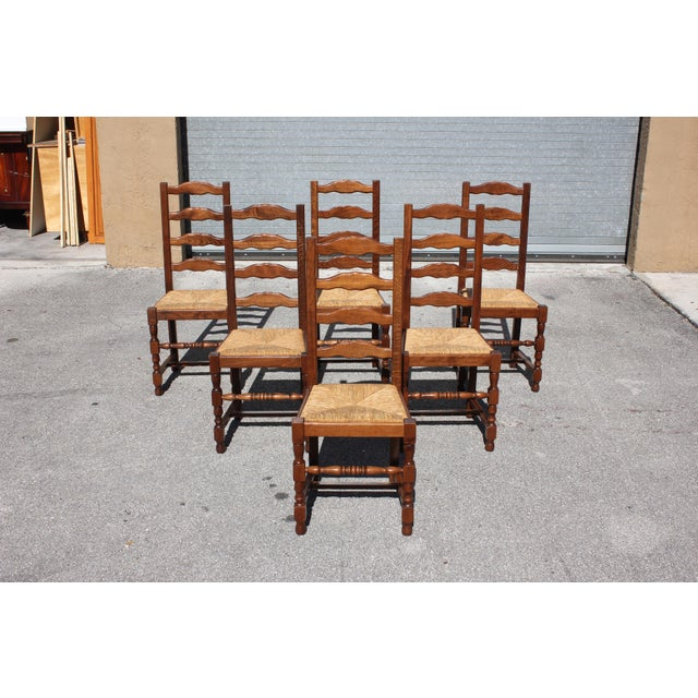 Set of six French Country chairs Solid walnut Circa 1910s, original rush seats are in good condition. The 6 Dining chair...