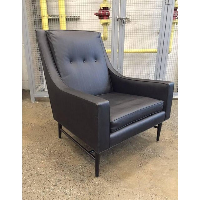 Harvey Probber lounge chair. Black vinyl upholstery with a lacquered stretcher base.