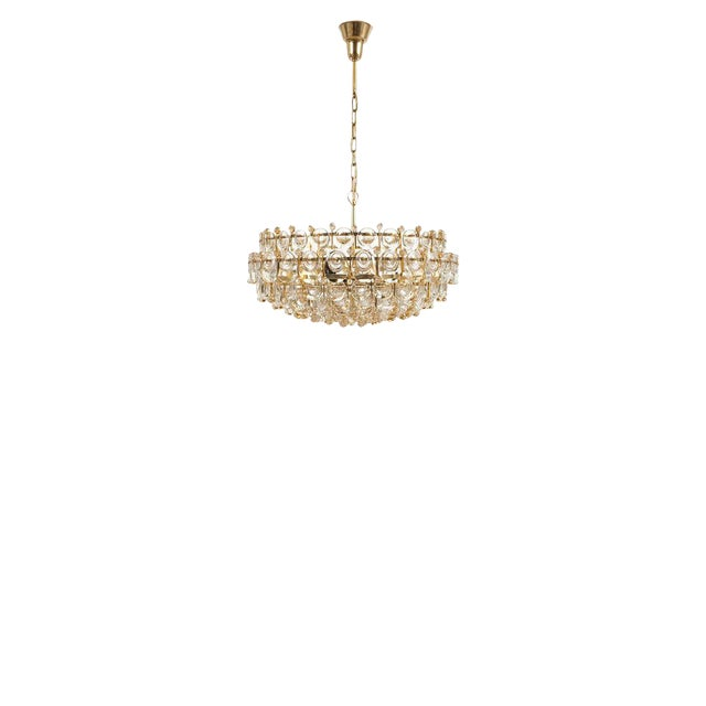 """Glamorous and very large 28"""" multi-tiered chandelier by Palwa with hundreds of smooth crystals in different sizes...."""