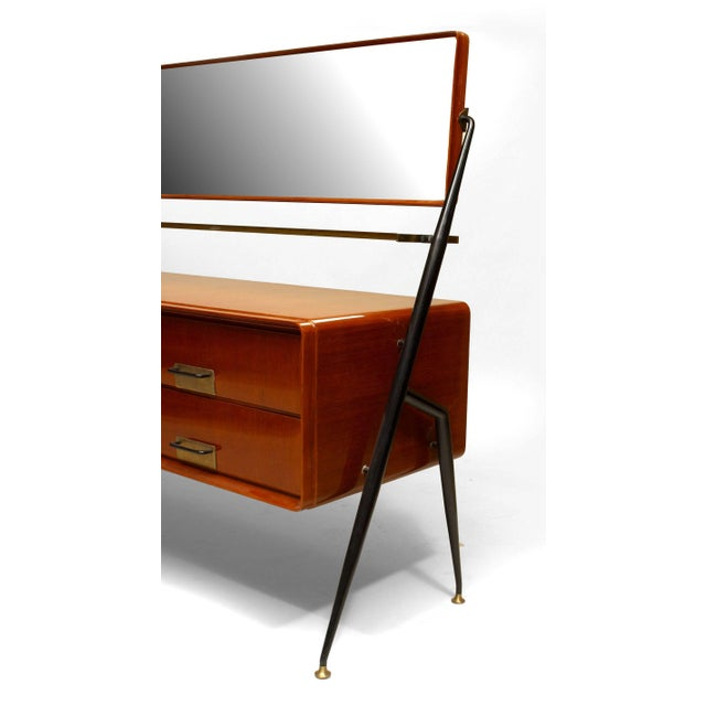 Italian 1960s mahogany chest with six drawers having a glass shelf under a swivel horizontal bevelled glass mirror...