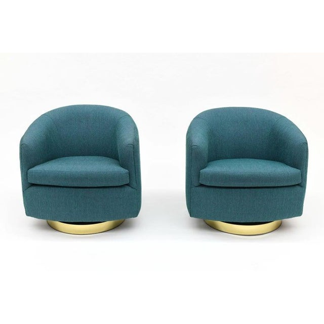 Beautiful pair of barrel lounge chairs by Milo Baughman for Thayer Coggin. Chairs swivel and tilt back. Bases are round...