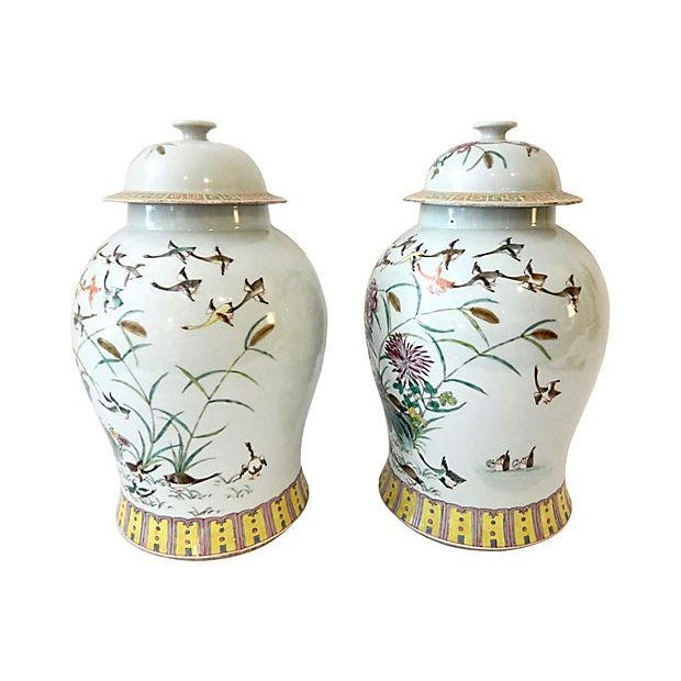 Superb elegant Pair of hand-painted famille rose ginger jars decorated with flowers and flying ducks. Marked on...