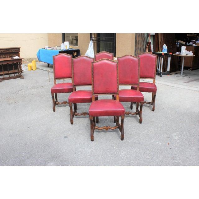Fine set of six Louis XIII style Os de Mouton dining chairs with chapeau de gendarme backs, circa 1880s. Vintage leather...