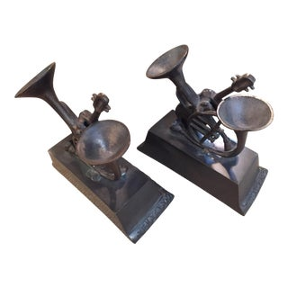 Patinated Brass Musical Bookends - A Pair For Sale