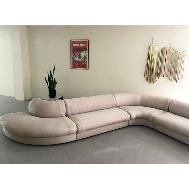 This monumental sofa boasts smooth & sensuous lines which can be arranged in an array of different configurations. This...