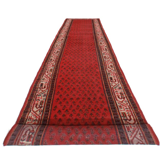 Antique hand knotted wool Persian Hamedan runner with a beautiful geometric design.