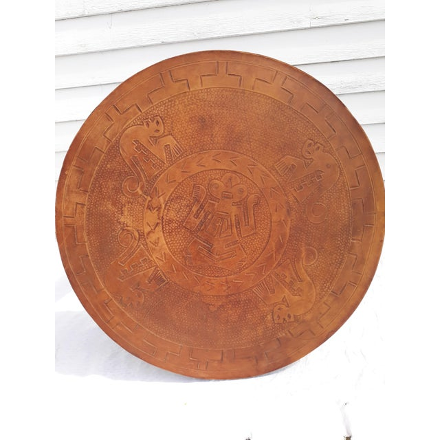 This is a stylish table designed by Pazmino in Ecuador. The table is in solid wood with a tooled leather top. It is in...