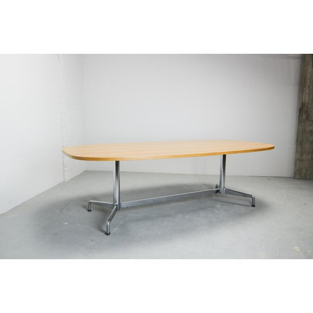 A large conference table designed by Charles and Ray Eames for Herman Miller in the 1960s. This table features an oval...