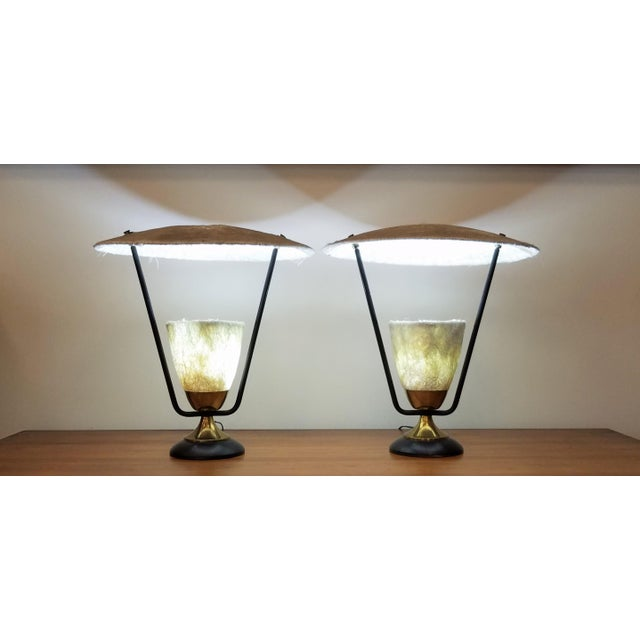 This pair of Mitchell Bobrick fiberglass table lamps for Lightolier will become a statement light in anyone's home. The...