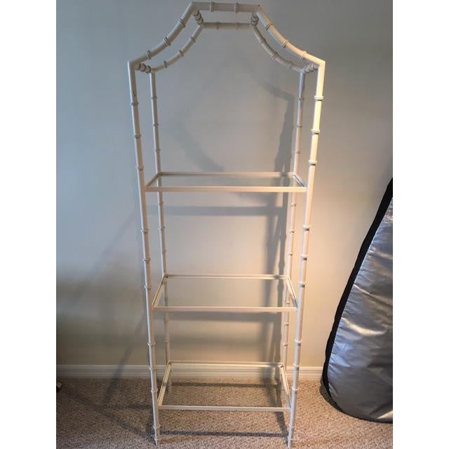 Vintage Palm Beach style faux bamboo etagere with pagoda top. Made of metal and painted a cream color. A few scuffs on the...