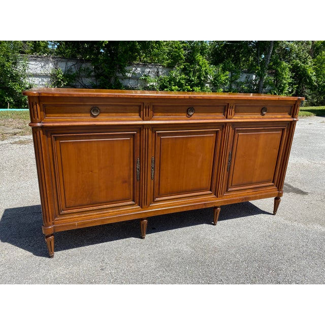 French Louis XVI style fruitwood sideboard, early 20th c. This is a timeless, classic piece that has an original working...