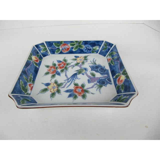 Beautiful blue and white chinoiserie porcelain catchall with flower and bird details. Could be used on a stand as art, as...
