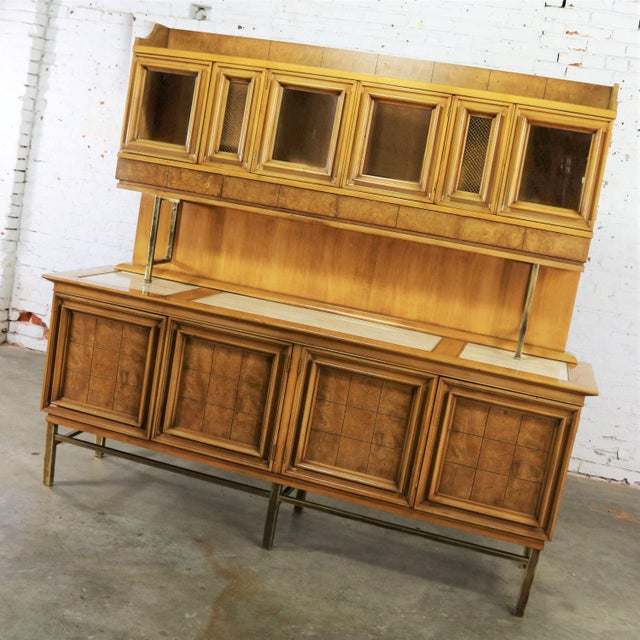Handsome credenza with hutch top attributed to the J. L. Metz Furniture Company from their Contempora line. Made of...