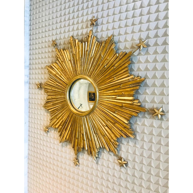 Exceptional sunburst mirror with extended star accents. Hand made by artisans using casting technique of wood, resin, and...