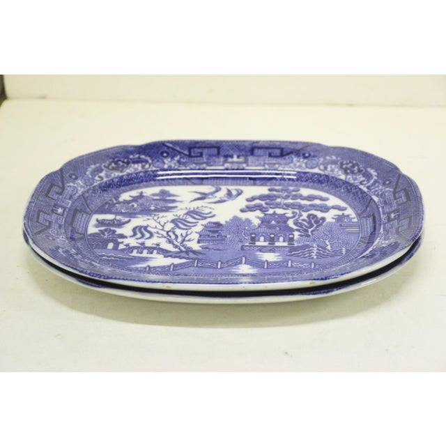 Pair of English Blue Willow Transferware platters manufactured by Charles Allerton & Sons, Circa 1929-1942. Minor surface...