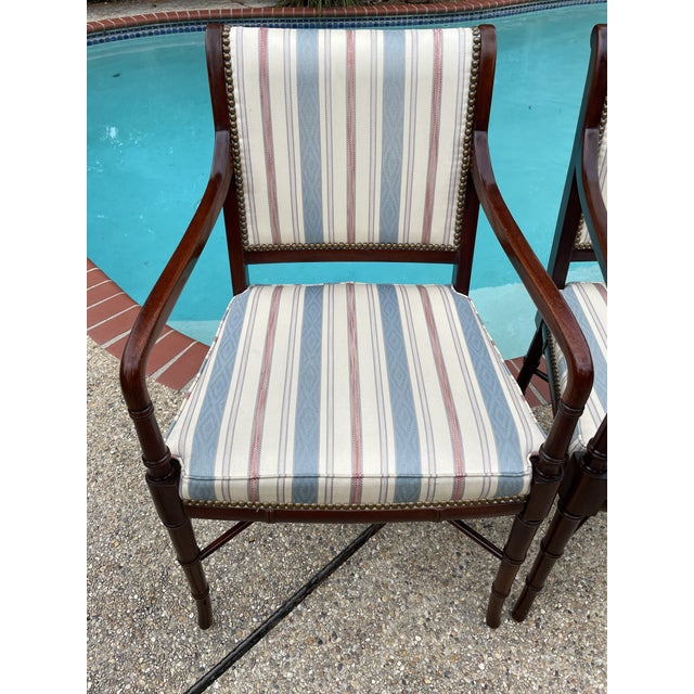 Vintage Sheridan style mahogany chairs with lovely curved arms. The wood is bamboo styled, upholstery is in very nice...