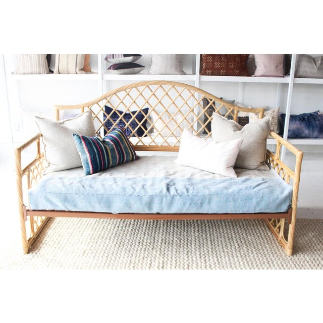 Vintage rattan day bed. Fits a twin size mattress perfectly.