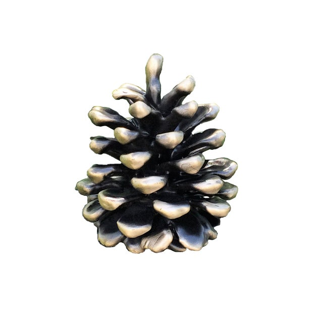 Not really large enough for common use as a newel post topper, our mid-size Ponderosa cone is most often used as a drapery...