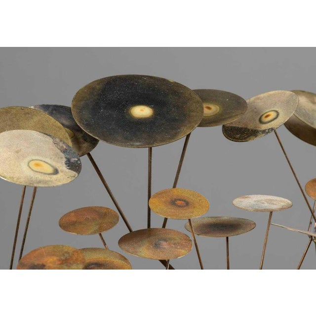 Curtis Jere raindrop mirror. Frame of mirror is made of circular shapes depicting raindrops in brass, copper and metal....