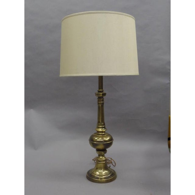 "Elegant pair of solid brass English table lamps in a baluster form. Height with shade is 38"". Brass table lamp diameter is..."