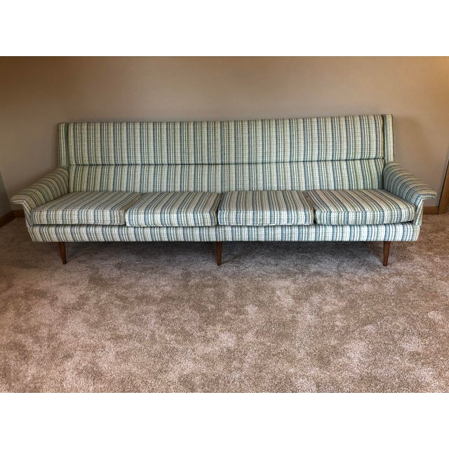 Classic Danish modern upholstered sofa. Extra long, High back. Firm support for small of back. Amazingly comfortable to...