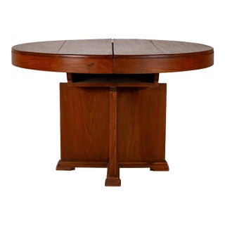 Antique Indonesian Dining Table with Central Folding Leaf and Geometric Base For Sale