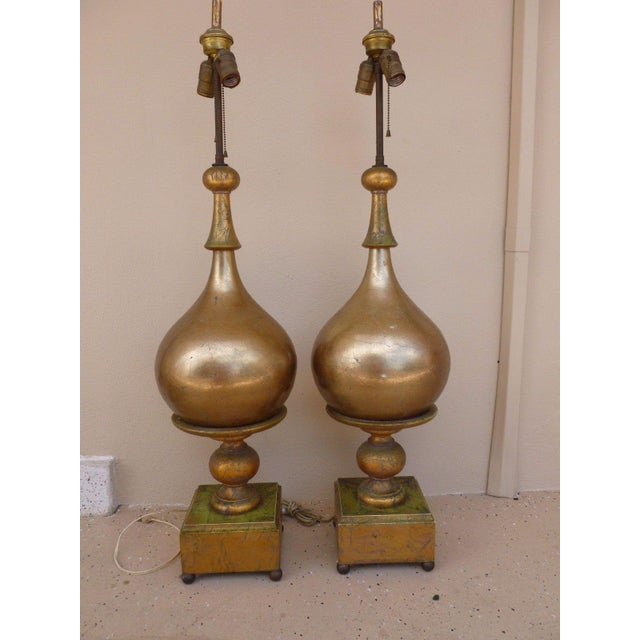 This is a fab pair of mid-century Hollywood regency style table lamps. The pieces feature exaggerated bulbous Italian...