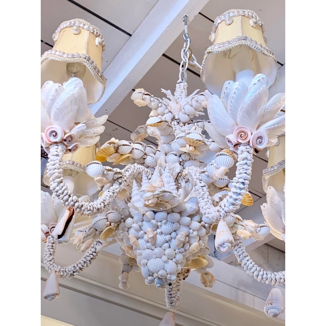 """Charming and ever-popular """"Charlotte"""" white and ivory 5-light chandelier encrusted with Pearled and matteSeashells. All..."""