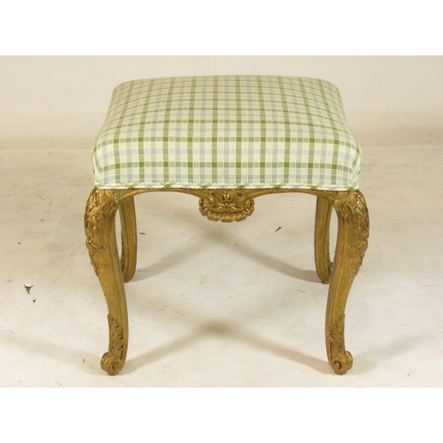 An exceptional 19th-C. French Regence Style gilt-wood bench seat with hand carved shell and acanthus leaf details.