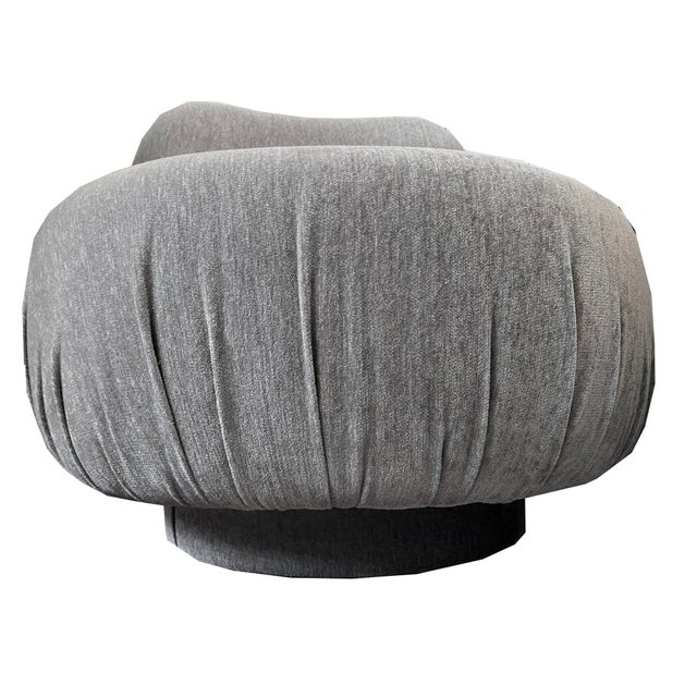 Vintage swivel chair. Reupholstered in a beautiful neutral fabric . Soft to the touch. A great silhouette that adds a...