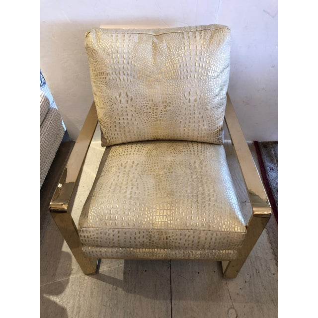 A show stealer glamour chair having chunky brass frame and sensational faux crocodile metallic upholstery that shimmers in...