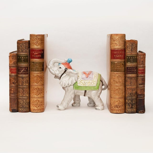 A lovely Japanese Porcelain Circus Elephant figurine as a bookend. Handmade and hand painted. Detailed. Beautiful colors....