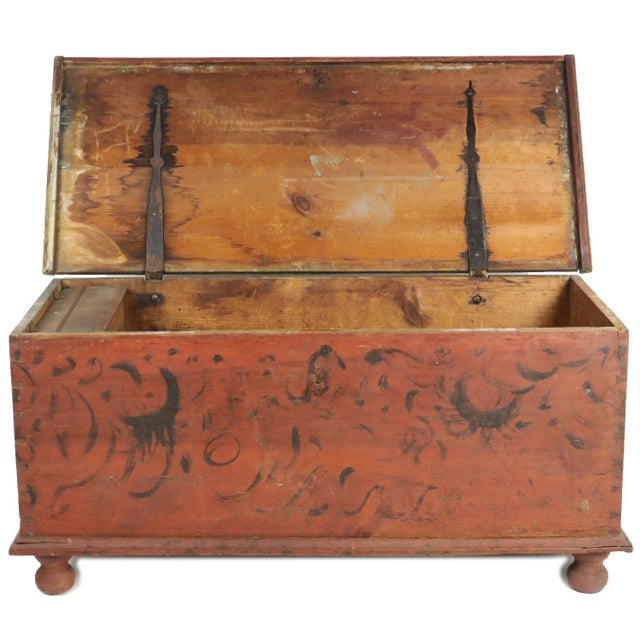 """Primitive Ball Foot Blanket Chest, 51"""" wide with original red paint and wrought strap hinges. The front, back and sides..."""