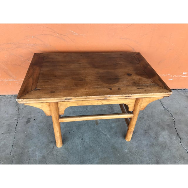 Rustic vintage Chinese low table. Top is variably faded but in good condition otherwise. Solid joinery, mid 20th Century...