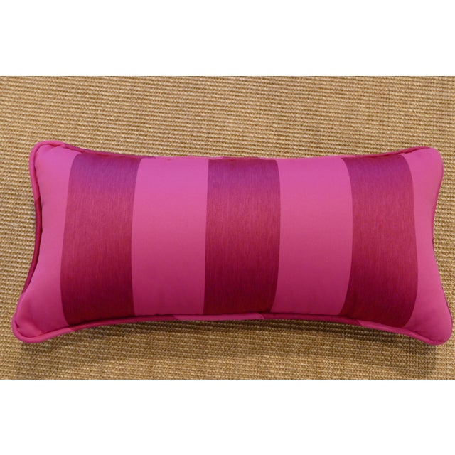 Rectangular striped pink pillow with piping and hidden zipper closure made from an Osborne & Little fabric. Perfect for an...