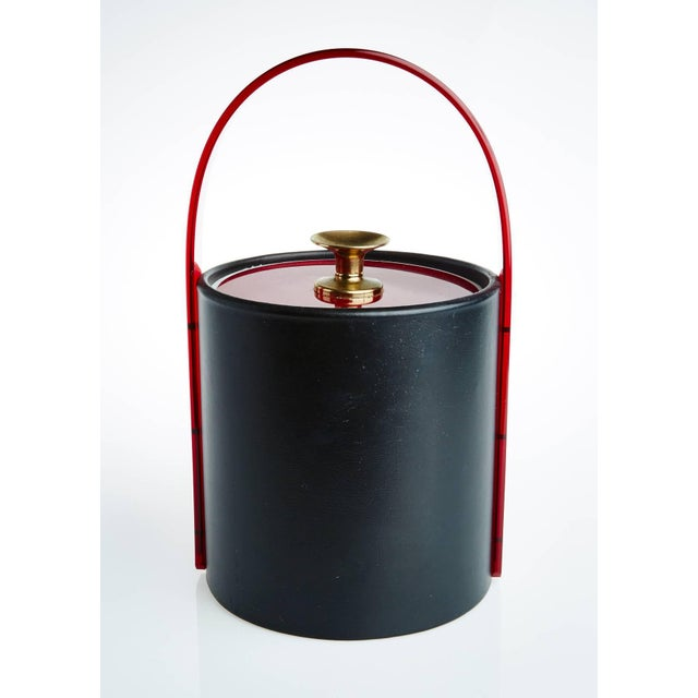 If you're looking for a vintage Classic to add to your bar cart this Art Deco style ice bucket would fit right in. Sleekly...