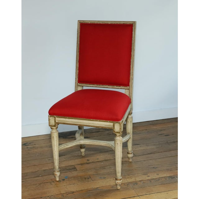 Charming French Provincial side chair with gilt detailing and fabulous red linen upholstery from the famed Waldorf Astoria...