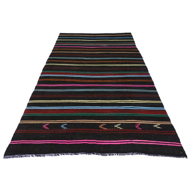 Highlighting the finest trends in design, this Boho Chic Vintage Turkish Kilim with Stripes and Modern Tribal Style...