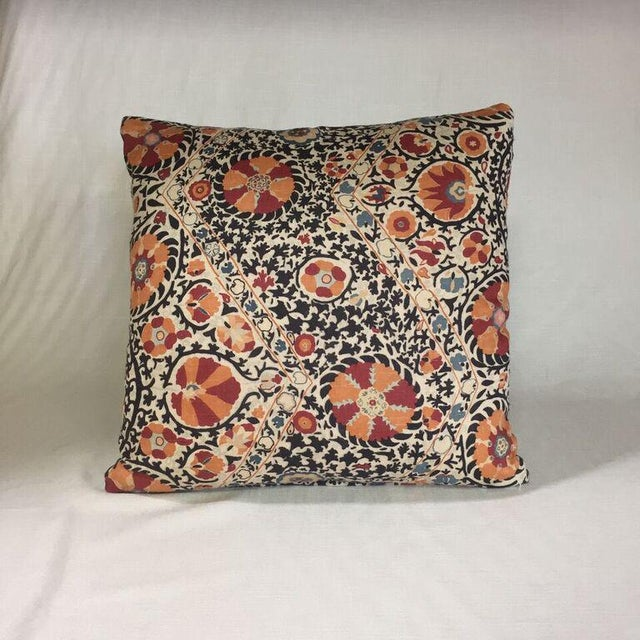 By Kim Salmela , a 22x22 pillow in designer fabrics. Woven tan cotton/poly reverse, knife edge finish, hidden zipper...