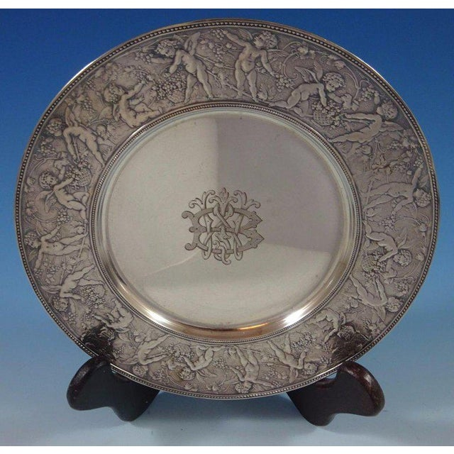 Tiffany and Co. Gorgeous Tiffany and Co sterling silver plate with exquisite winged cherubs, and flowers and fruit along...