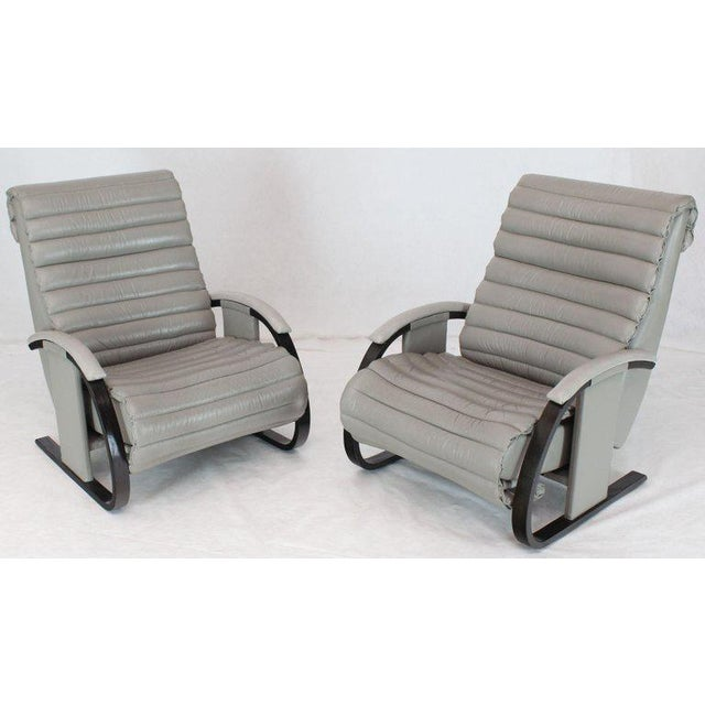 Pair of Mid-Century Modern bentwood rails ribbed upholstery super comfortable great looking leather lounge recliners.