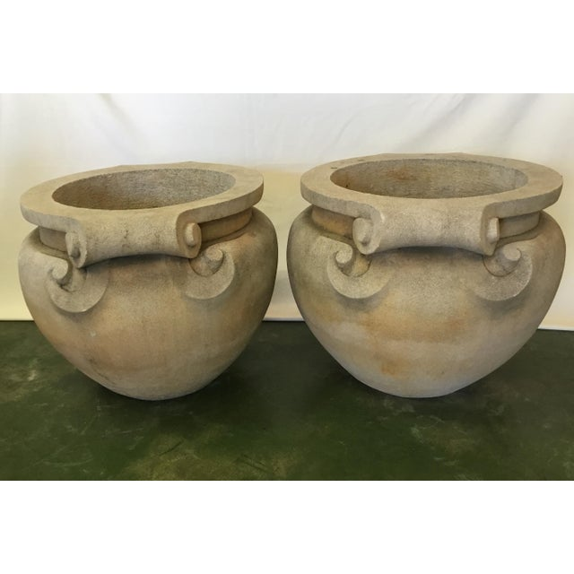 This magnificent pair of planters feature a scroll design on each side that curl gracefully. With their clean classical...