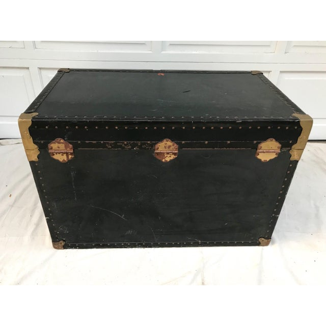 This ain't your average trunk, it's big and beautiful! The piece is painted a dark green with black leather trim and brass...