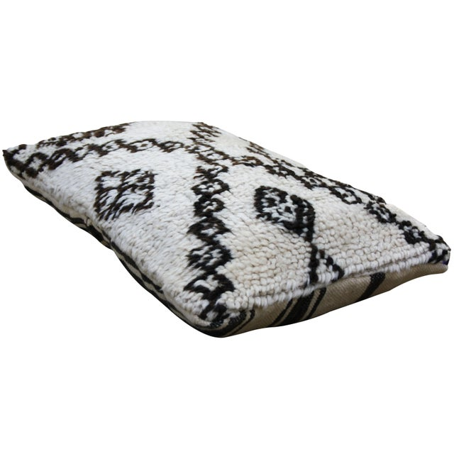 Moroccan Beni Ourain pillow from the High Atlas Mountains. Handloomed of soft organic wool with an ornate harlequin...