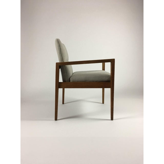 Vintage Jens Risom walnut armchair hailing from the mid 1960s. Beautifully tapered legs are pleasing from all angles. Arms...