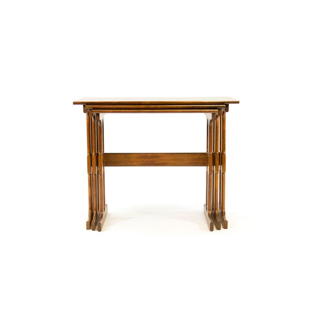 FREE SHIPPING IN THE U.S. This is a set of three rosewood nesting or stacking tables by CF Christensen (CFC Silkeborg). We...