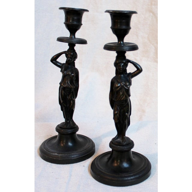 Offered is a pair of Bronze Caryatid candlesticks circa late 19th century. Wonderful for placing on opposite sides of your...
