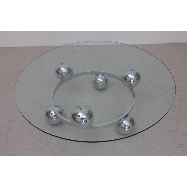 Wonderful Sputnik coffee table with six chrome balls on one-tier. Excellent condition. Clear glass top.